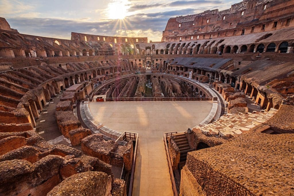 Scenic view of Roman Colosseum interior at sunset, Rome Italy
