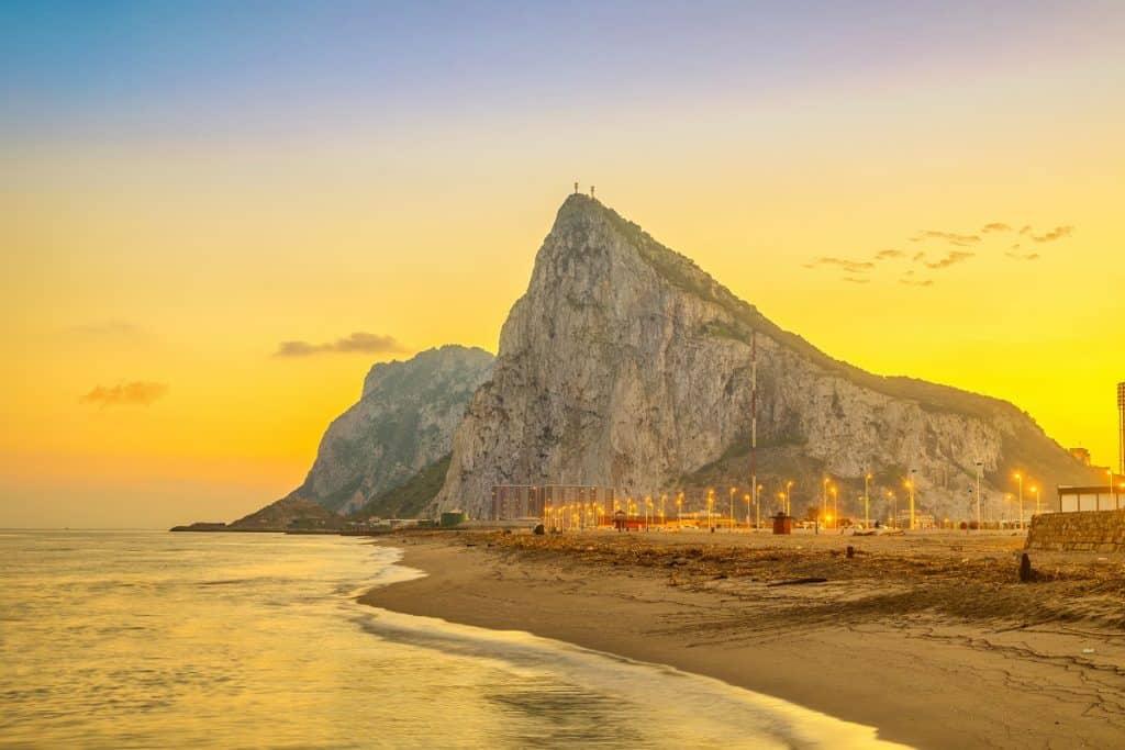 Gibraltar rock at sunset from beach in La Linea de la Concepcion